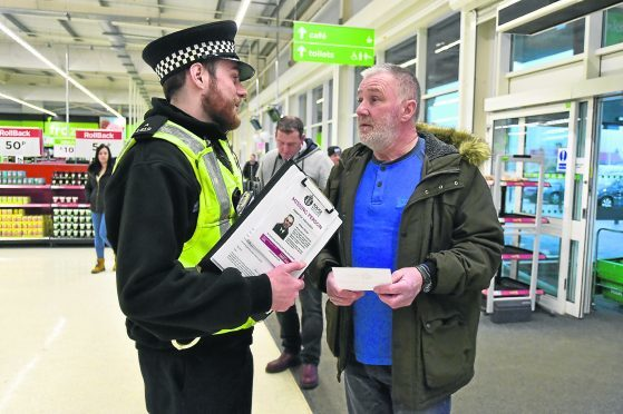 Police issued leaflets to shoppers at Asda in Fraserburgh