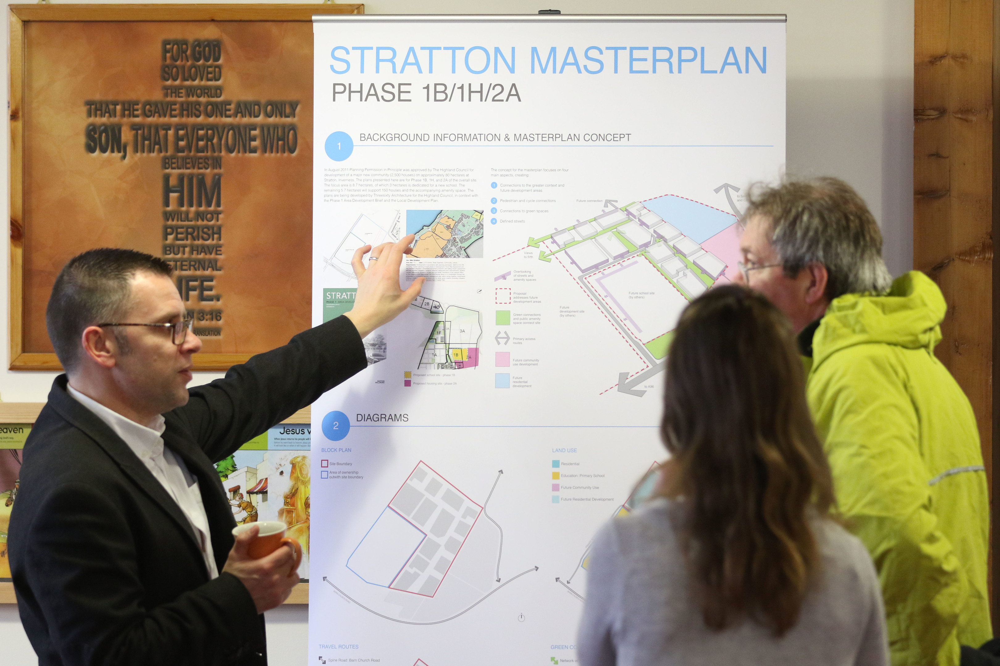 Plans for a new housing development near Smithton in Inverness on display at Smithton Free Church. This pic: Rory Kellett and Skye Sturm from Threesixty Architecture discussed the plans with Martin MacLeod from nearby Balloch
