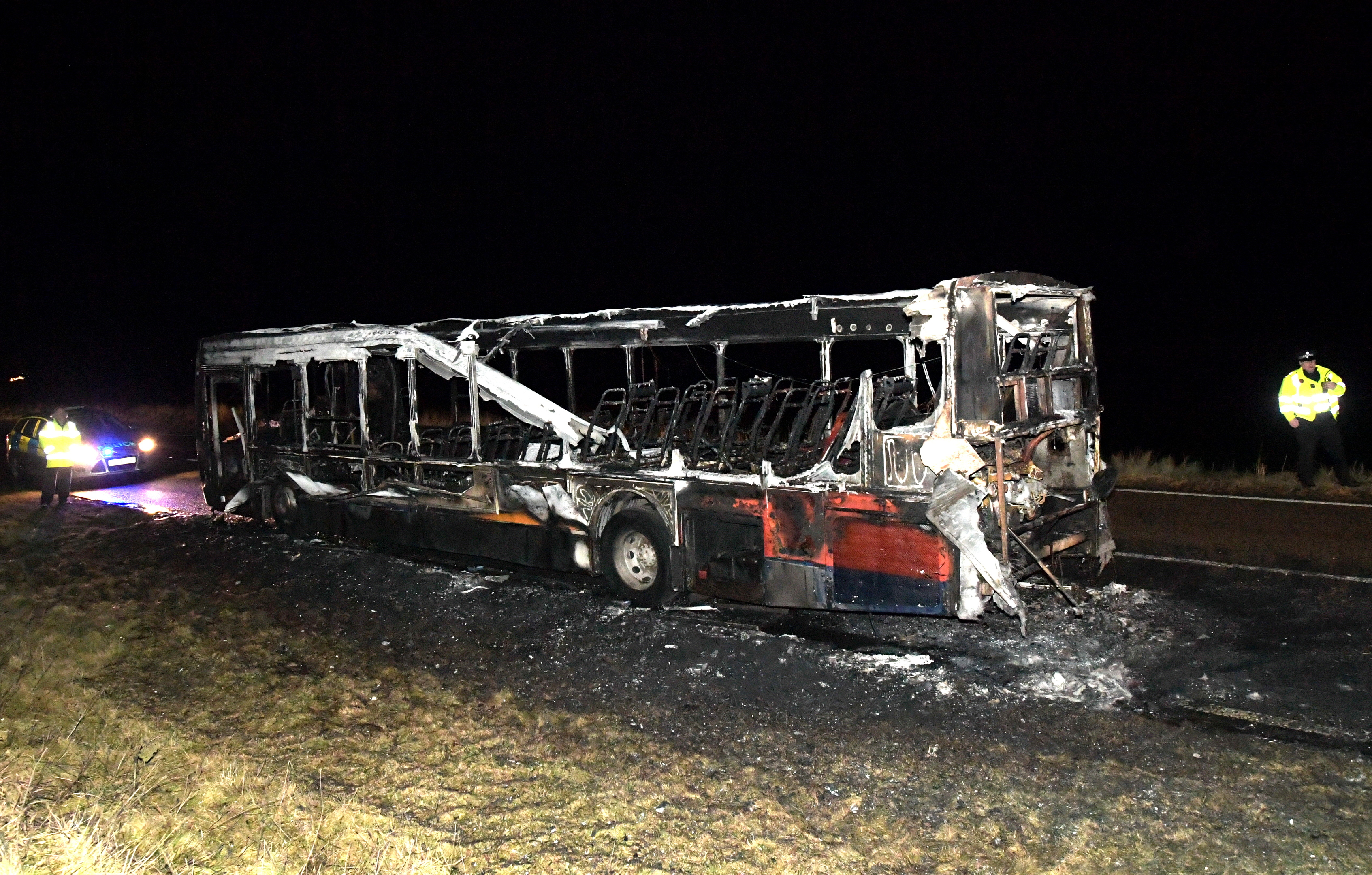 The burnt out shell of a bus which caught fire on the A90 near Stirling Village