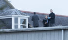 Police and fire personnel on the roof. Picture: Derek Ironside / Newsline Media