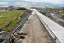 The £750million Aberdeen bypass was due to be completed by the end of this month.