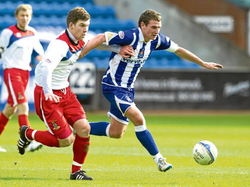 Kilmarnock's Craig Bryson (right) is challenged by Gavin Morrison in 2011