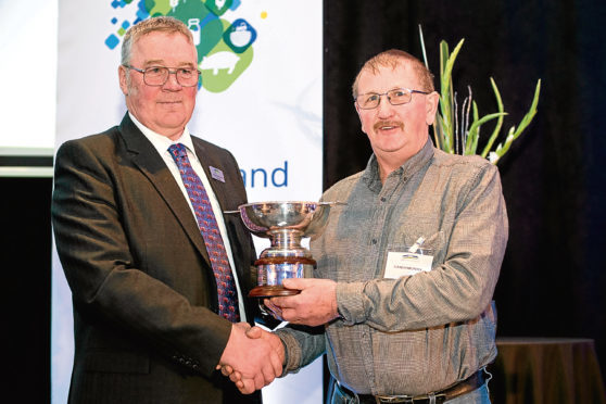 NFU Scotland president Andrew McCornick presents the union's David Miskelly award to Sutherland crofter Sandy Murray