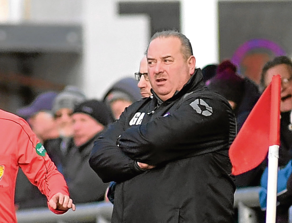 Turriff's manager Graeme Roy on the touchline.