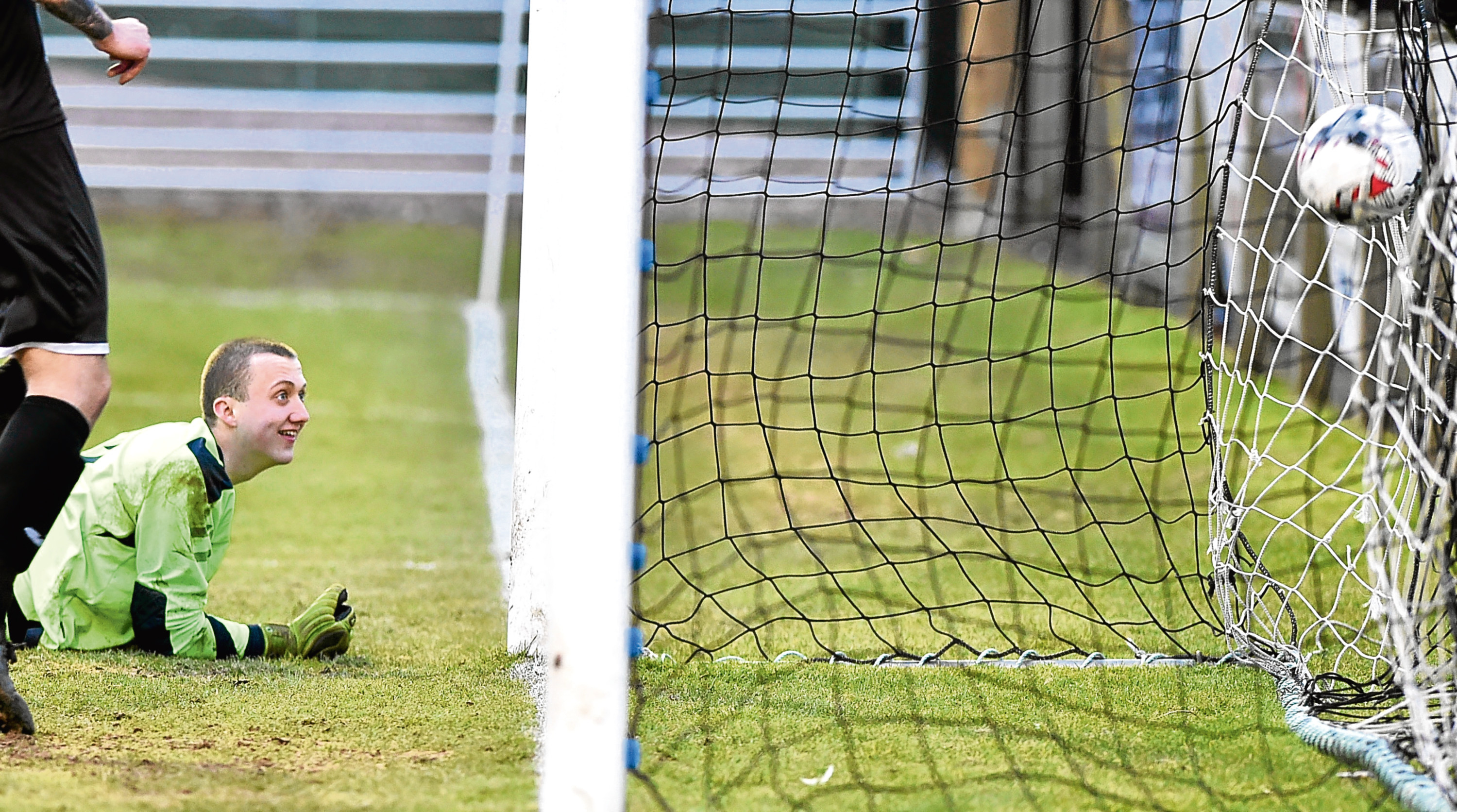 Fort William keeper Martin MacKinnon watches the 9th goal go into his net. Pictures by Colin Rennie.