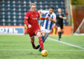 Kilmarnock's Jordan Jones and Mark Nicolson contest the ball