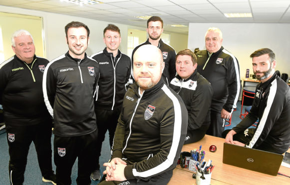 In the foreground Steven Ferguson, Academy Director, while also in the photograph are (L-R) Jim Kelly,Charlie McPhee, Gregor Campbell, Calum MacAskill, Richard Brittain, Davie Kirkwood and Stuart Kettlewell who all work within the academy. Picture by Sandy McCook.
