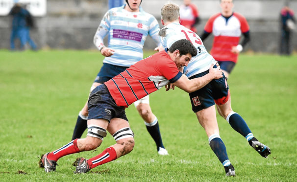 RUGBY ;  BT National League Division 1 ;  Aberdeen Grammar (red) v Edinburgh Accies (blue/white) -      Pictured - Grammar's Will Alton tackling Robbie Chalmers      Picture by Kami Thomson    13/1/18