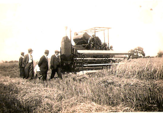 A Massey Harris combine 21 at work at Craigie farm in Fife during WWII