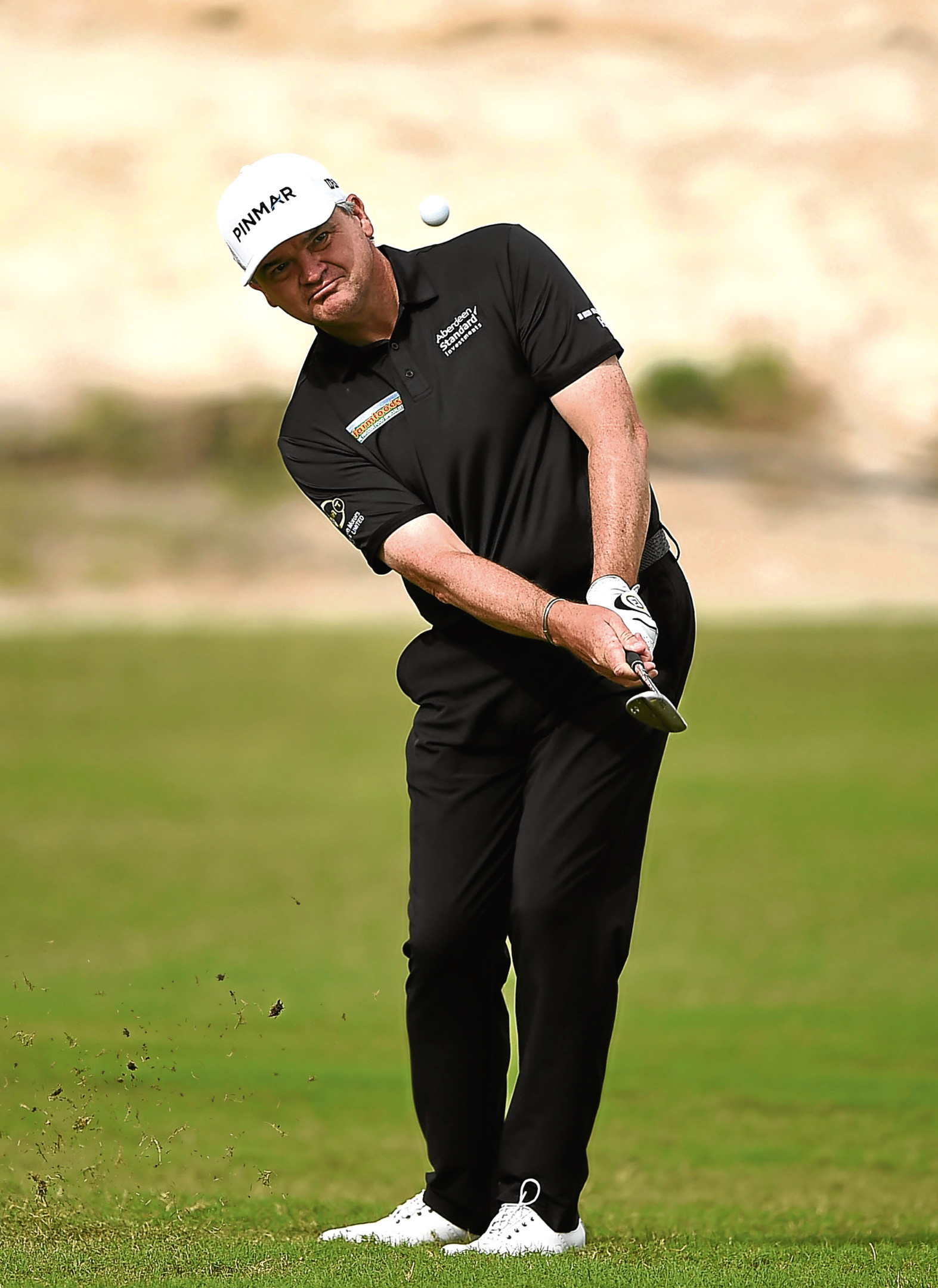 Paul Lawrie takes a shot from the 16th fairway prior to the Commercial Bank Qatar Masters at Doha Golf Club