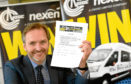 ****NOTE - CONTACT DETAILS FOR THE WINNER ARE ON THE TICKET**** Press and Journal / Nexen, Community Mini Bus Competition.     Pictured - Chair of Nexen UK CSR committee who made the draw for the winner of the mini bus, holds the winning ticket.       Picture by Kami Thomson    22-02-18