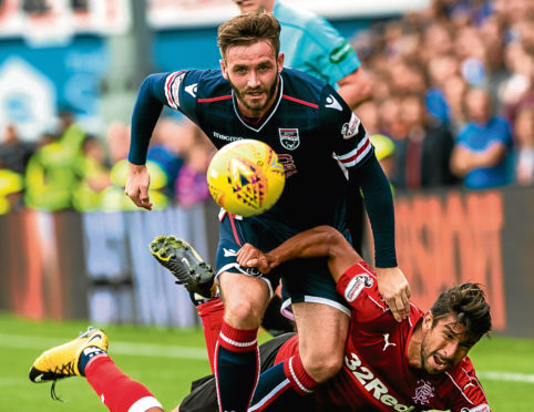 Ross County defender Jason Naismith has joined Peterborough United.