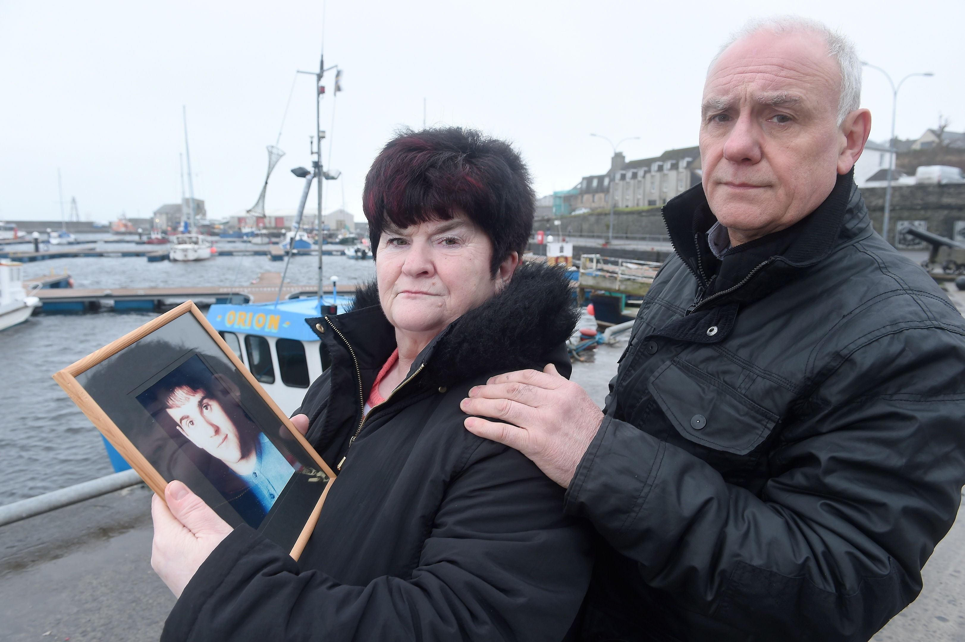 Hugh and June McLeod with a photograph of their late son Kevin