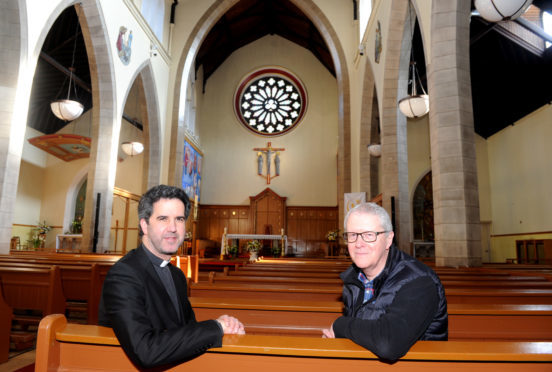 Pictured from left Father Keith Herrera cor priest at St Mary's and Robin Harding the parish manager inside the cathedral