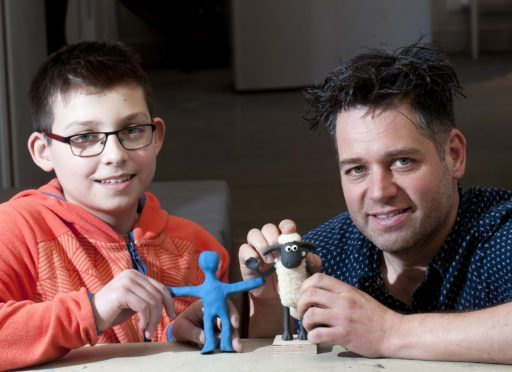 Aardman animator Andy Symanowski, pictured right, with Neo Hatch.