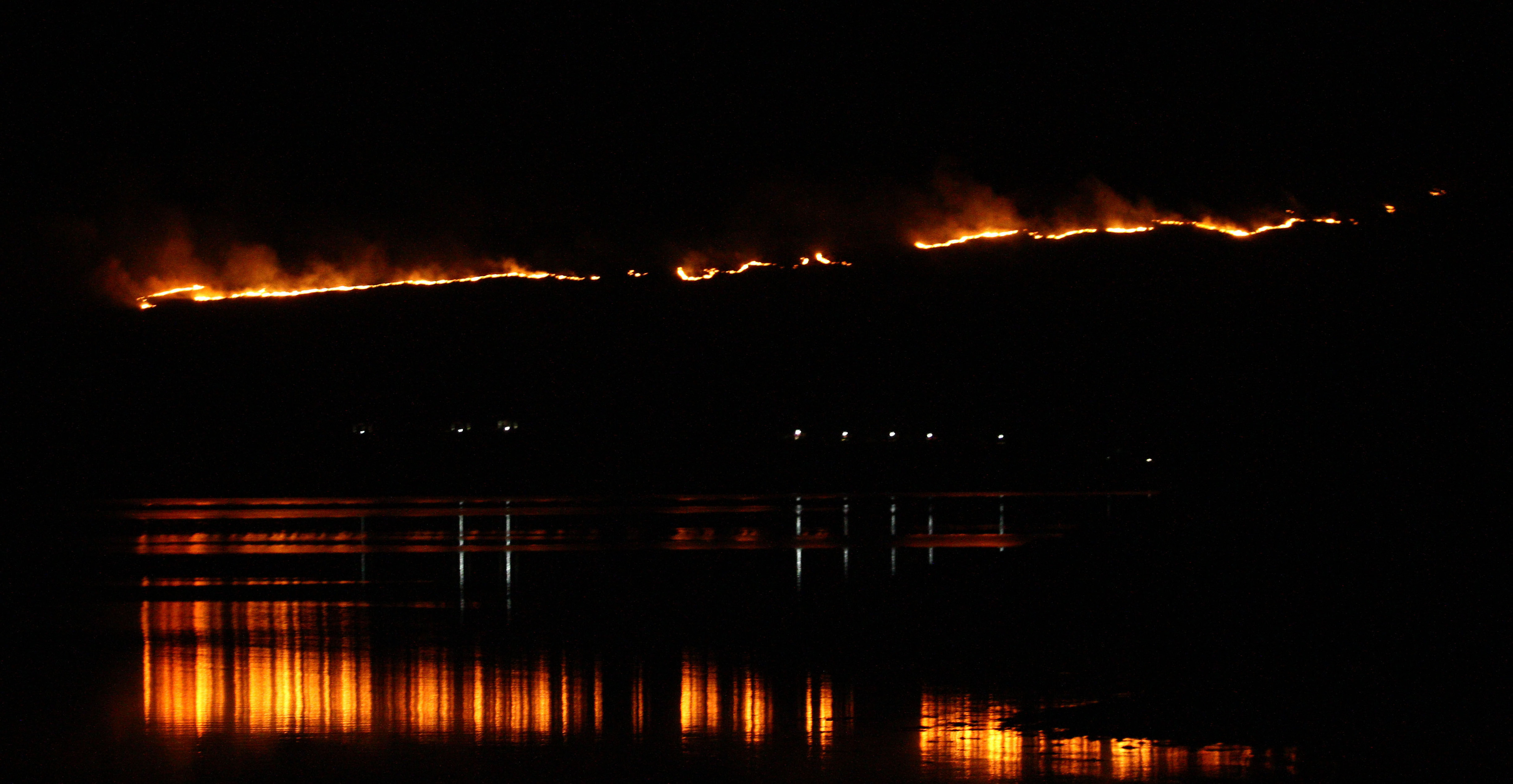 hill on fire above properties and creagan inn near appin argyll picture kevin mcglynn