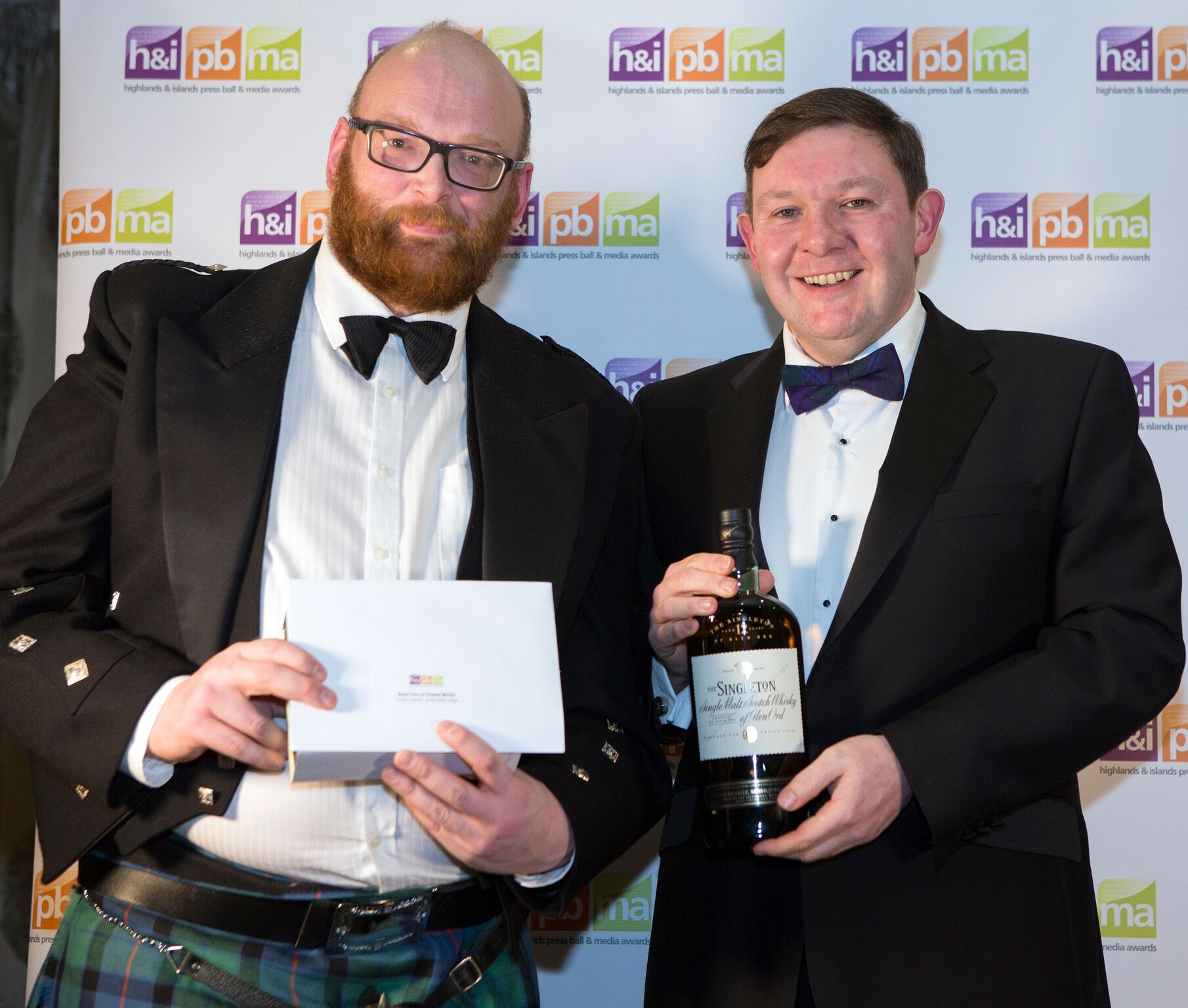 Chris Lemon, owner and editor of Inverness Gigs and Keith Miller from award sponsors Diageo