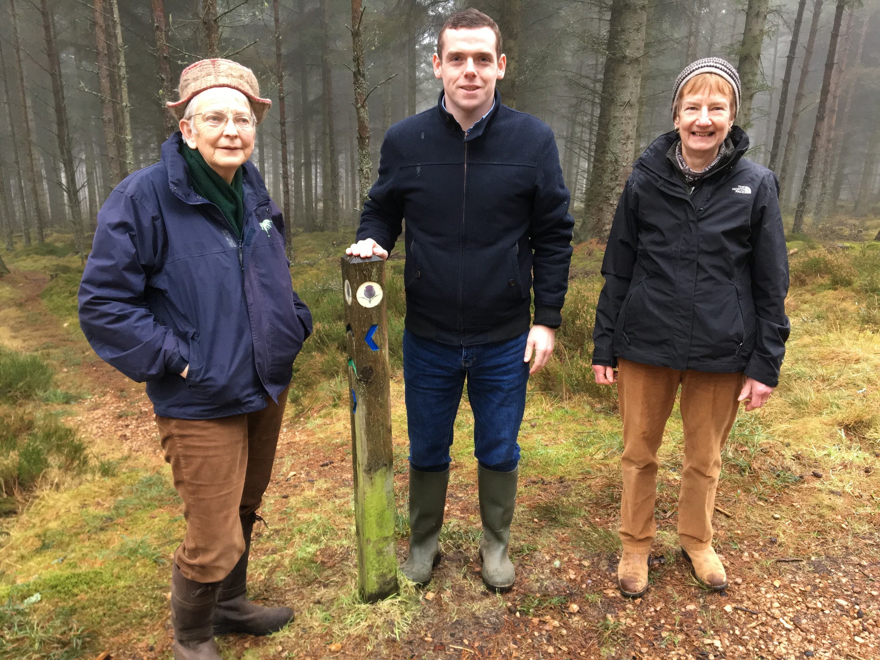 Mary Stelmach, chairwoman of Balloch Riders' Access Group, Moray MP Douglas Ross and vice-chairwoman Liz Jones in Balloch Wood.