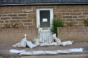 Cleaning up after previous flooding at Forsyth Street, Hopeman, Moray