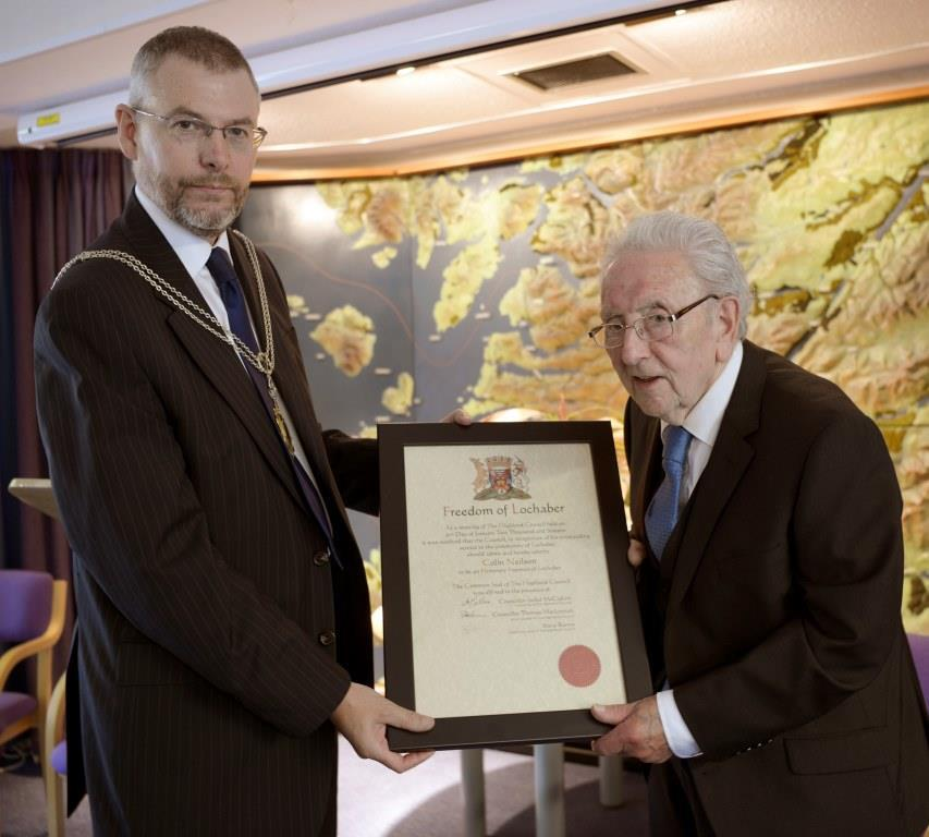 Colin Neilson (right) is presented with the Freedom of Lochaber Scroll by Councillor Thomas MacLennan. Picture:  Iain Ferguson, The Write Image