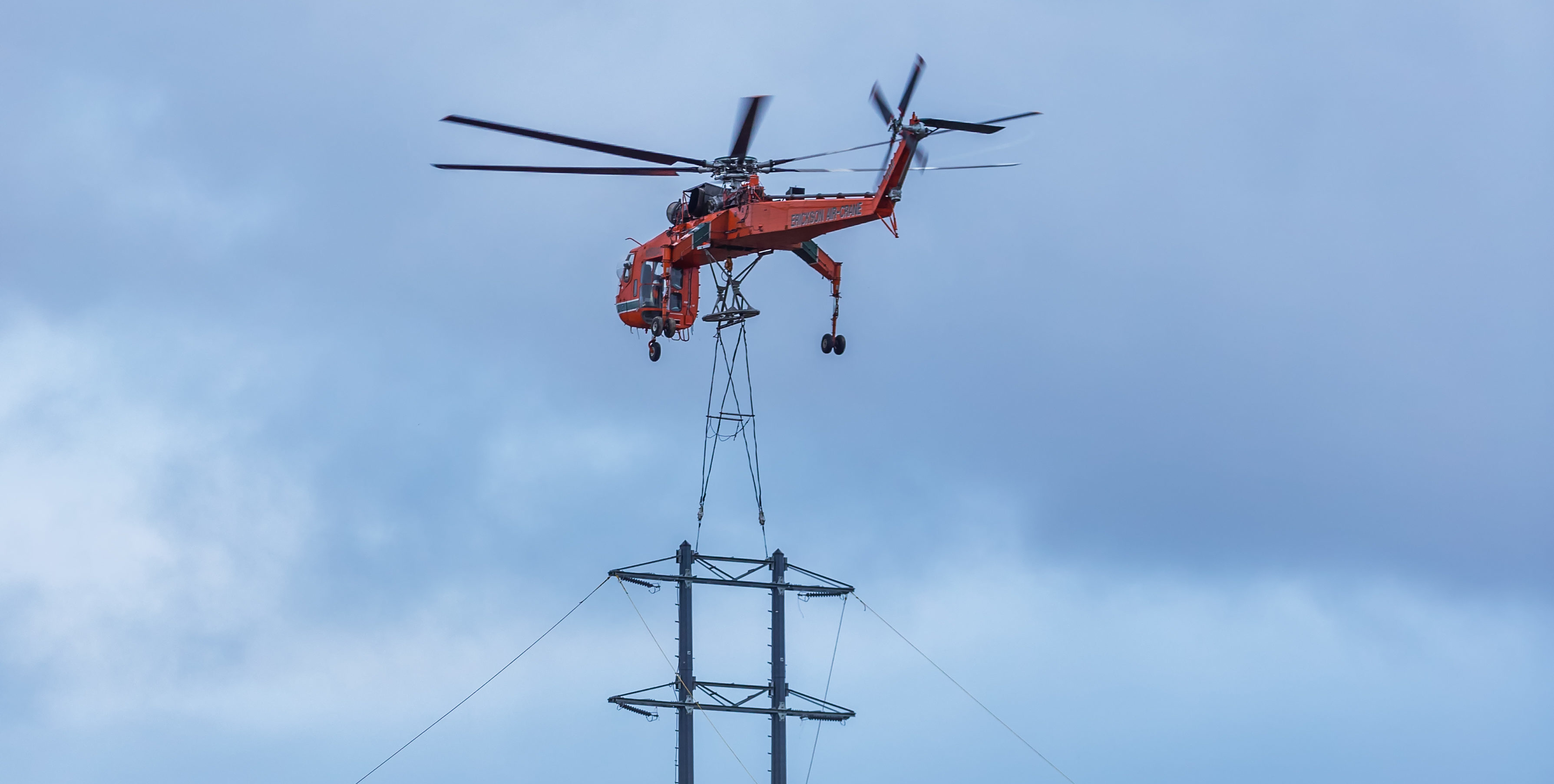 This is the Erickson Air Crane Helicopter lifting an Electricity Pylon from the Bafor and Beatty Storage Yard near Keith, Moray to set in place for the new Electricity Line. Photographed on 2 February 2018 by Brian Smith, Jasperimage, Tel 07917 848 732
