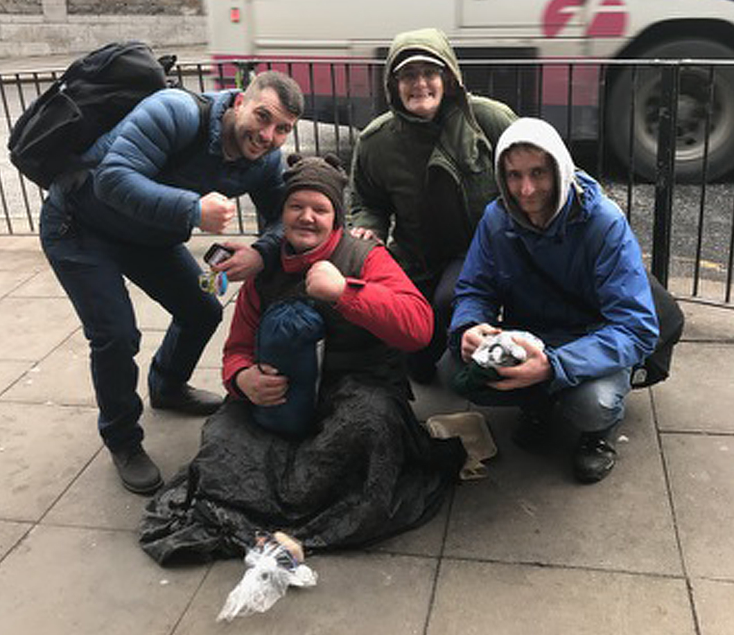 Lee McAllister hands out packages to homeless people in Aberdeen.