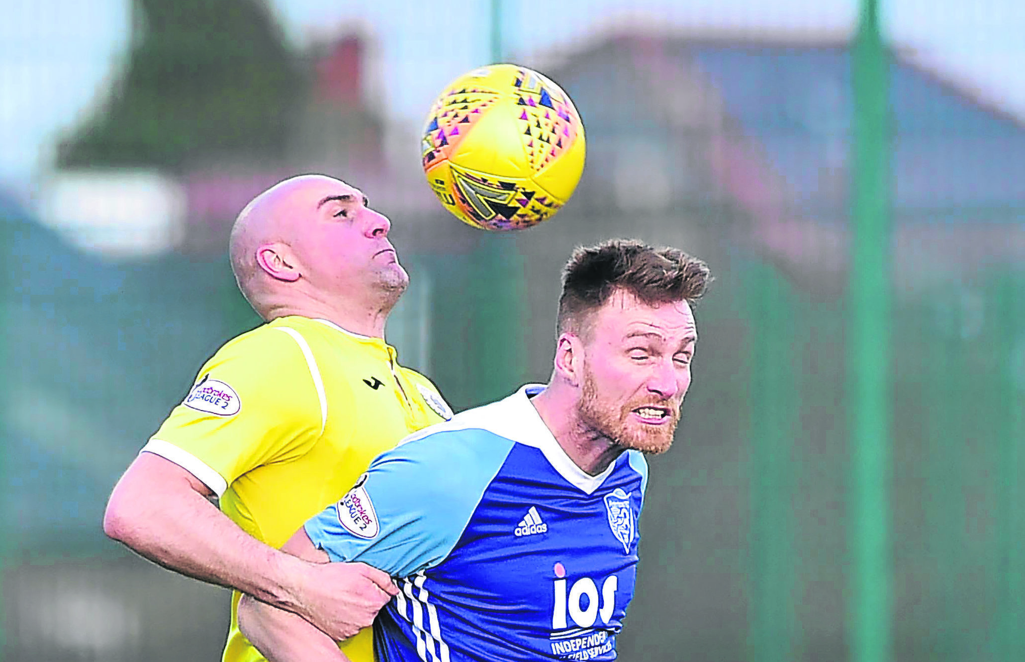 PETERHEAD'S RORY MCALLISTER IS HELD BY PAT SCULLION