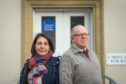 Moray Citzens Advice Bureau manager, Mary Riley, and volunteer James Workman outside the group's offices on Moss Street.