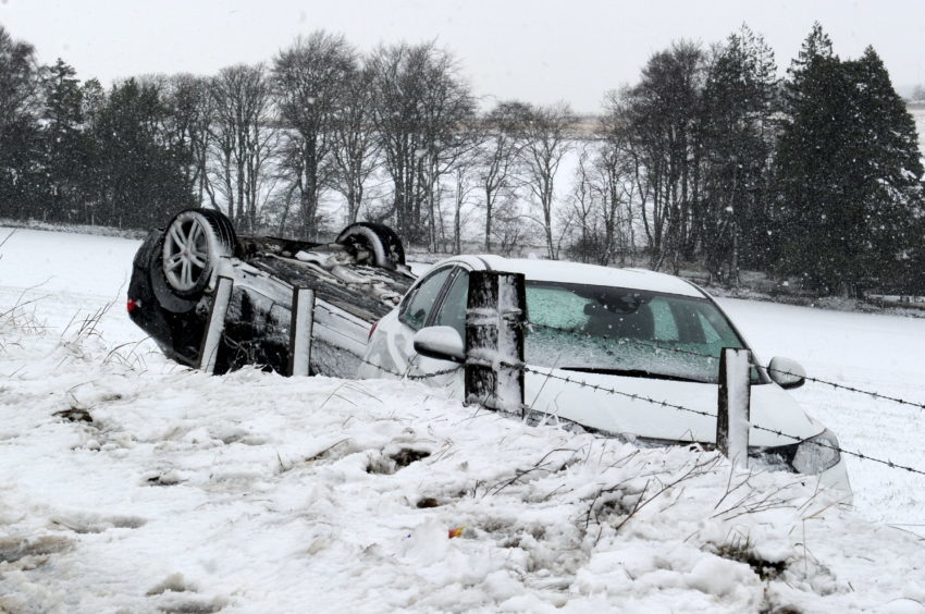 Police Scotland at the scene of a Road Traffic Collision (RTC) on Westhill Drive to the B979 junction, following a few cars has gone off the road and one flipped onto its roof.  Picture by KENNY ELRICK     14/02/2018