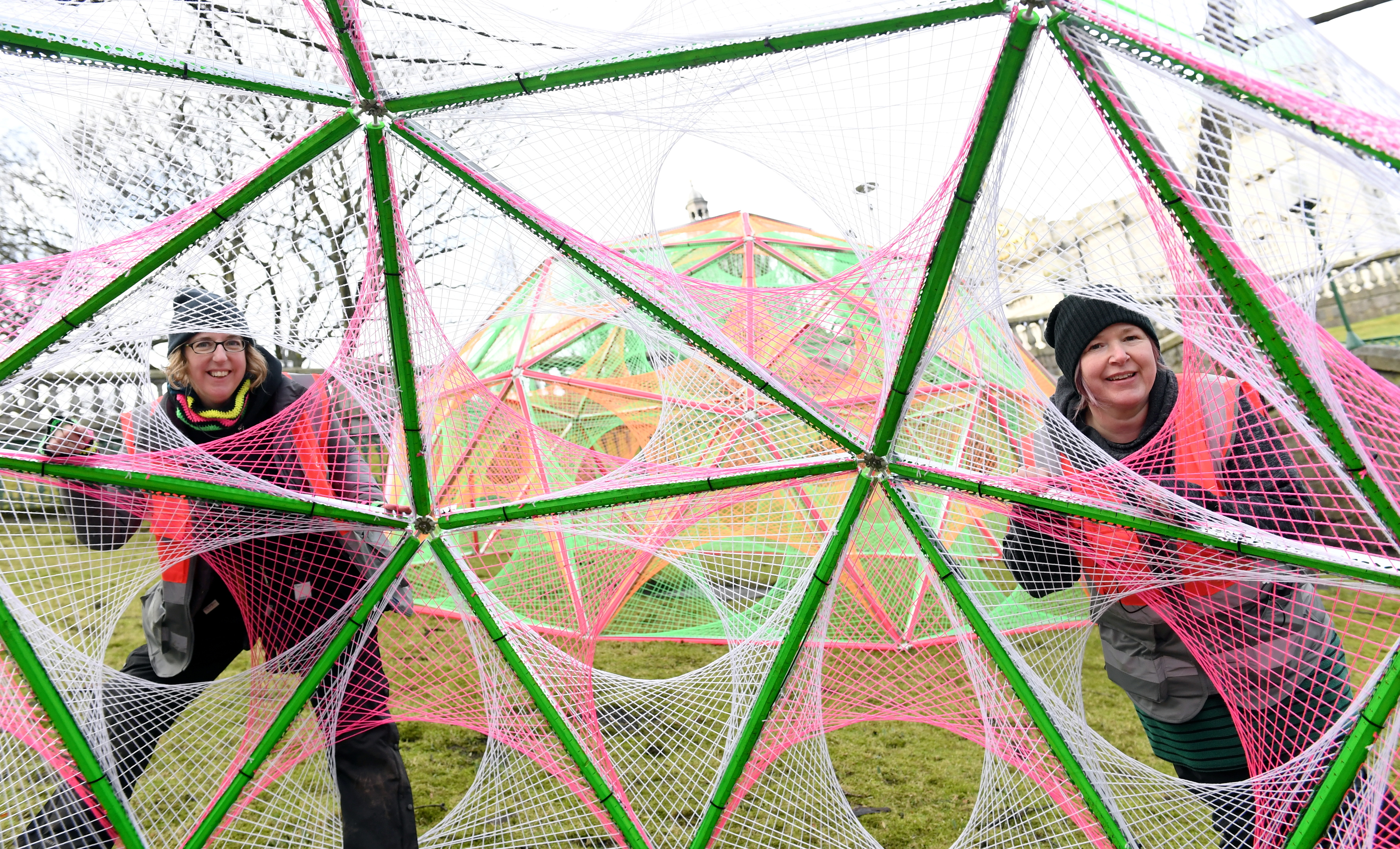 Artists Hannah Ayre (left) and Amanda Yates at one of their installations in the gardens.     Picture by Kami Thomson