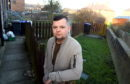 Jamie Findlay at his back garden at Churchill Drive, Peterhead, where drug users have been leaving used needles.