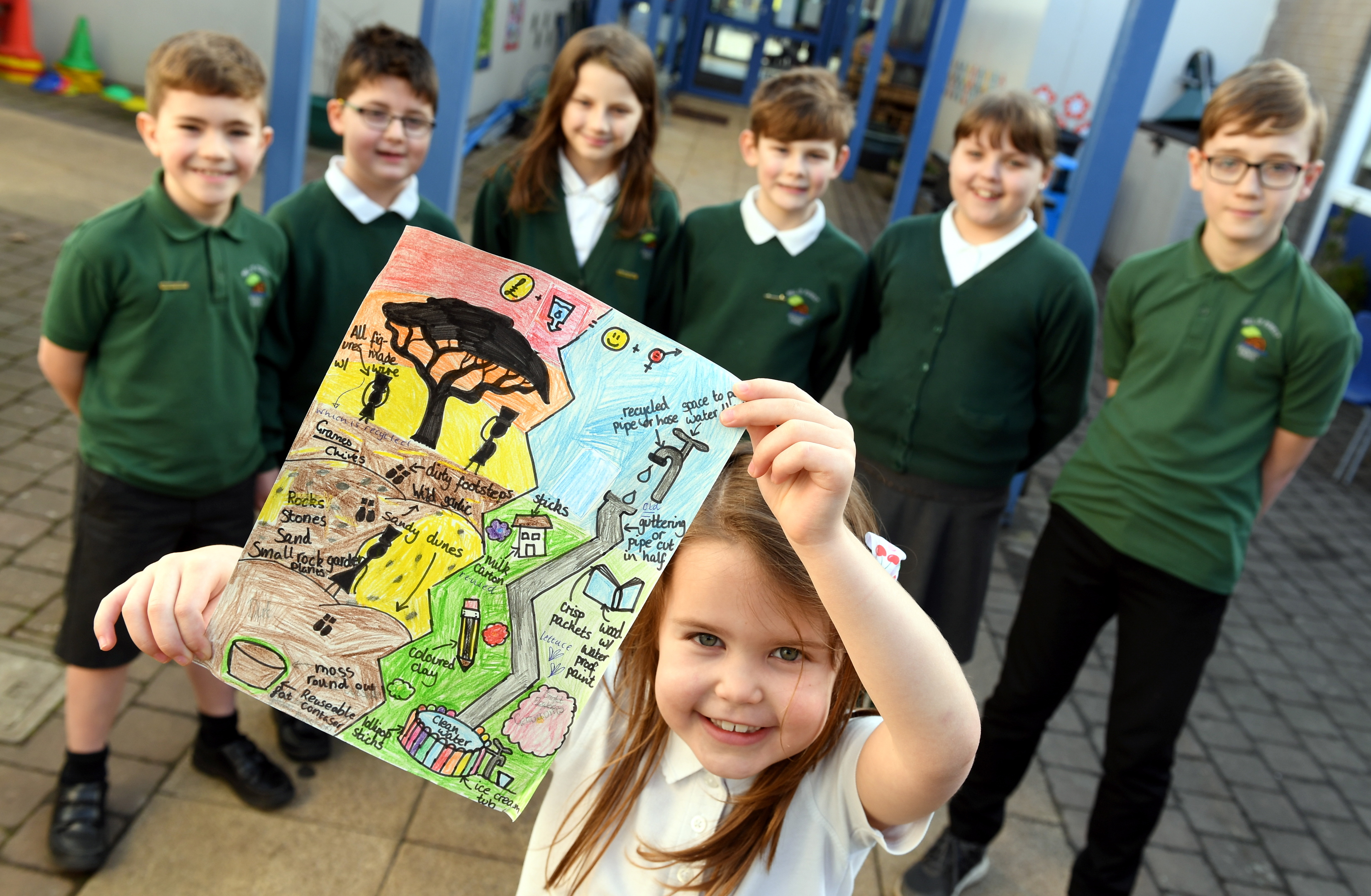 Their creations will be brought to life for display at the Gardening Scotland exhibition in Edinburgh this June.     Pictured - Mill O' Forest pupil Jenna Warden holding their design with fellow pupils L-R Elijah Kriston, Shaun Cadger, Keira Kirk, Harry Middleton, Rhea Walker, Murray Jamieson.    Picture by Kami Thomson    21-02-18