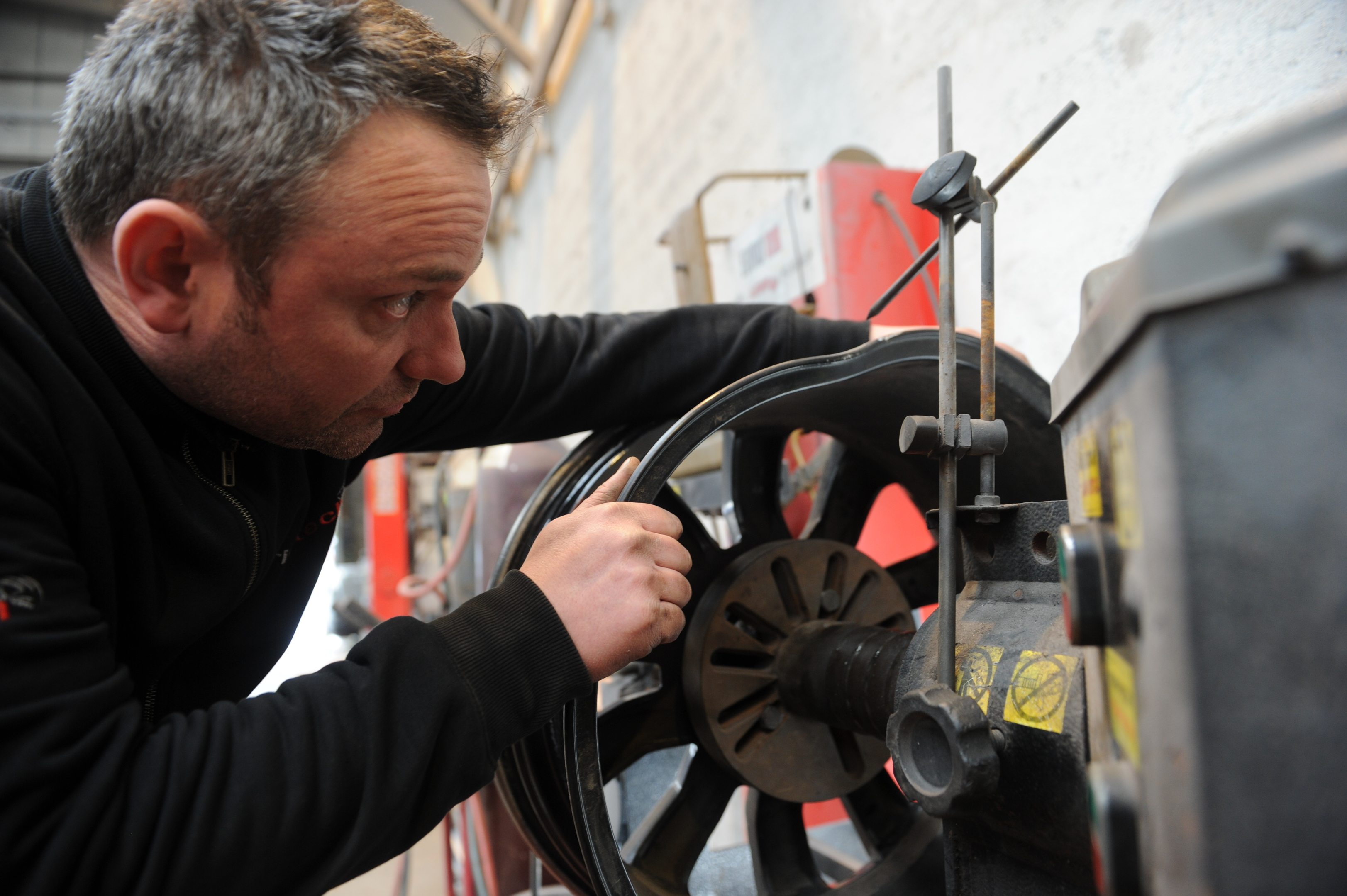 Jason Massie owns Rimtech wheel specialists in Inverness and has seen a large increase in the number of wheel repairs required as a result of pothole damage this year. Picture by Sandy McCook.