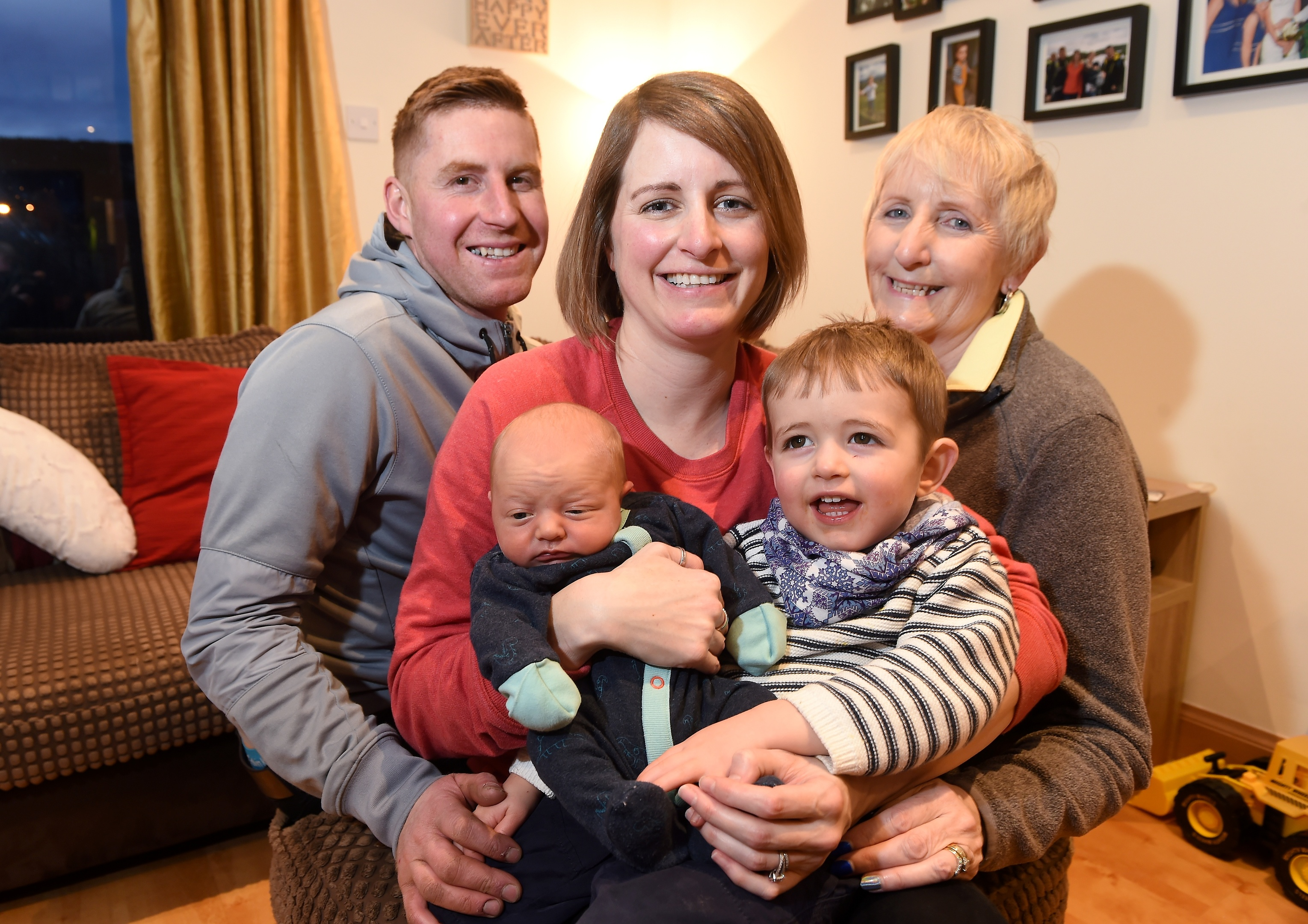 Baby Kier Ross of Aviemore who was born last Friday morning in a layby off the A9 photographed with dad Darren, mum Laura, big brother Roan (2) and granny, Maureen Chisholm who acted as midwife. Picture by Sandy McCook.