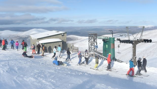 Skiers on the slopes at the Cairngorm Mountain.