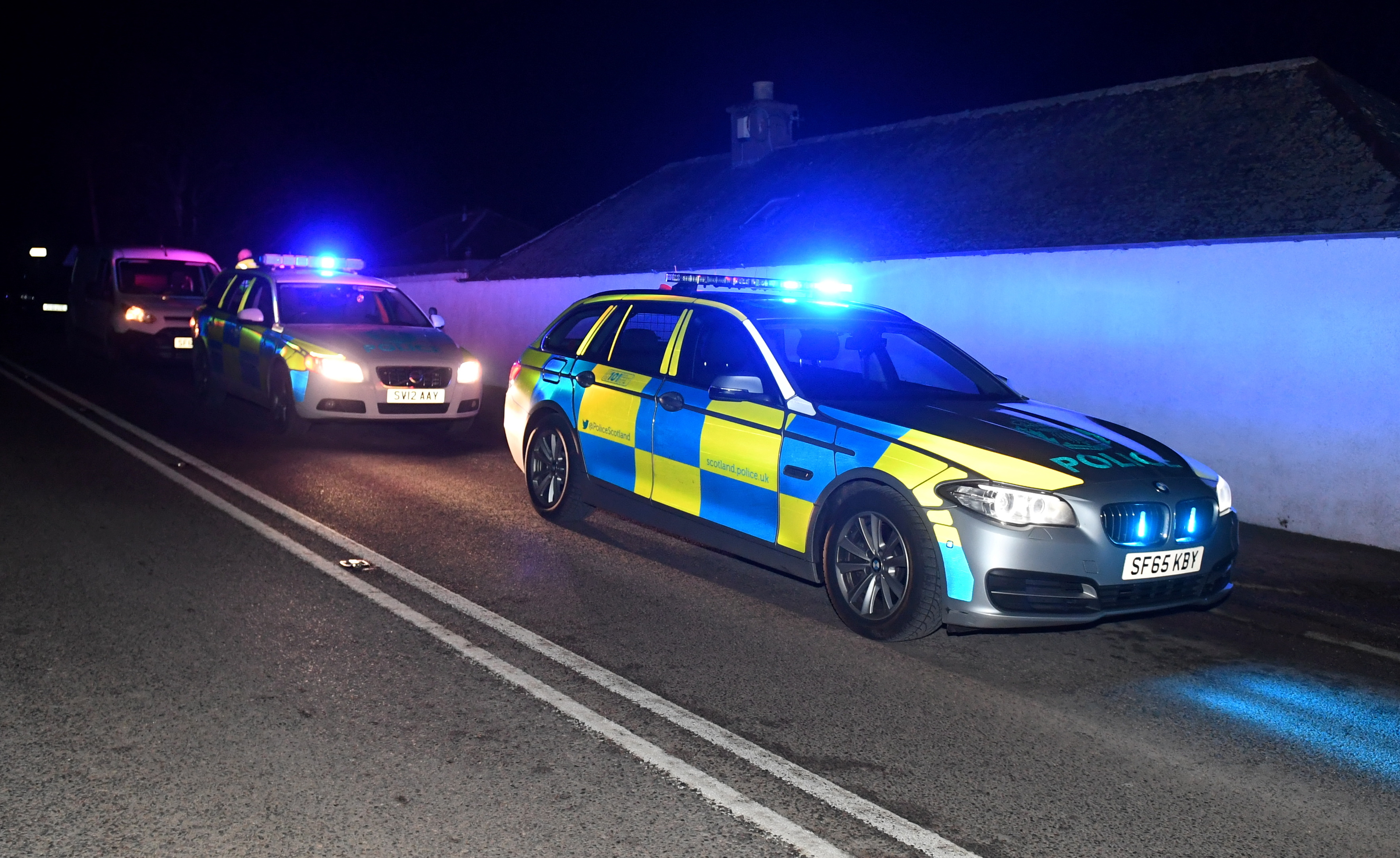 Police cars at the scene of the crash on the A93 between Ballater and Crathie. Picture by Chris Sumner.