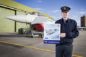 Flight Lieutenant Danny Streames with the stamp featuring a Typhoon jet.
