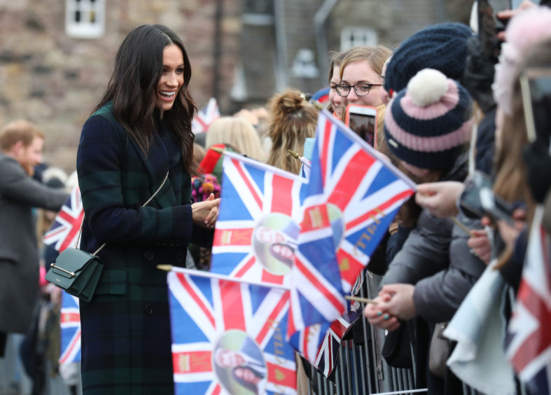 Meghan Markle meets well wishers during a walkabout on the esplanade at Edinburgh Castle