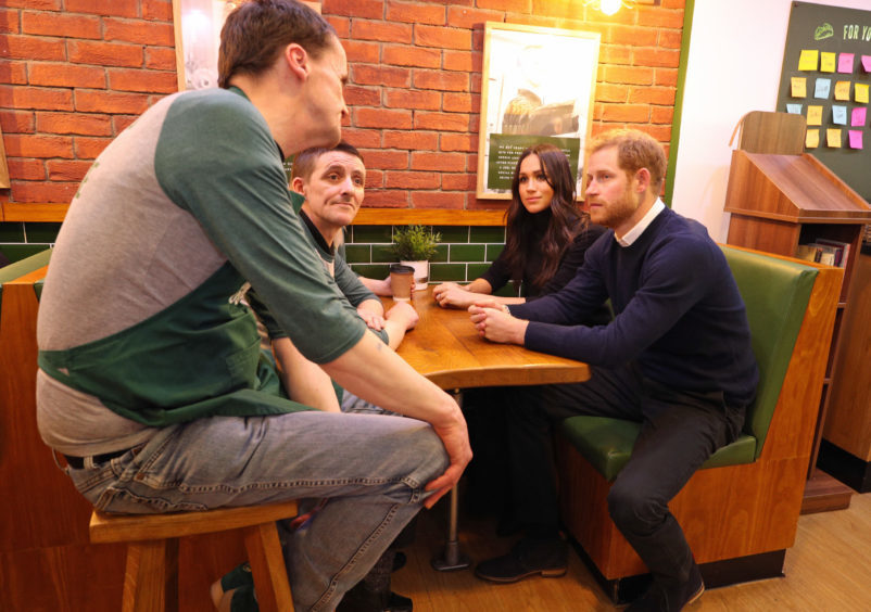 Prince Harry and Meghan Markle during a visit to Social Bite in Edinburgh