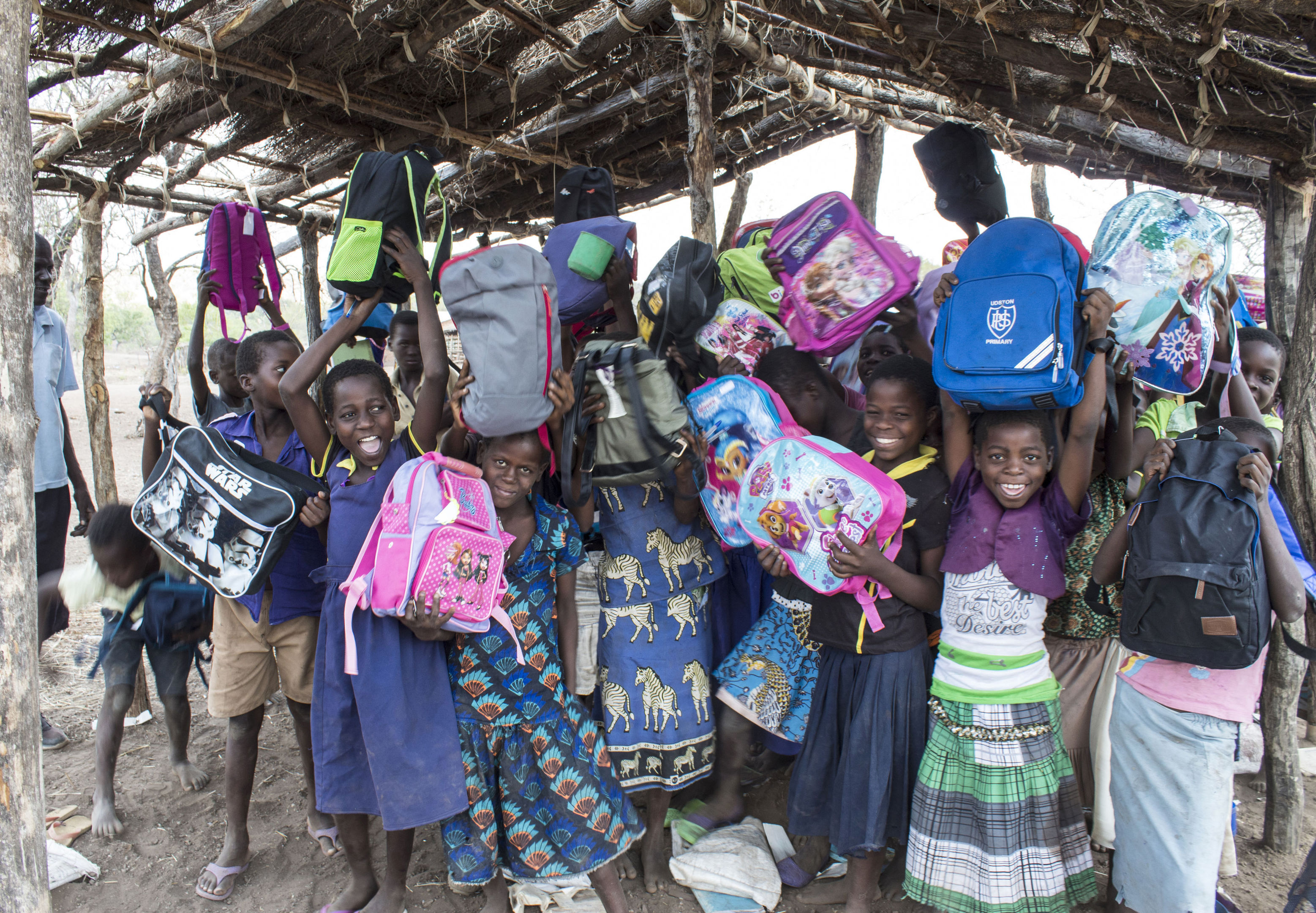 Children from Ngabu Primary School in Malawi with some of the 500,000 bags given out by Mary's Meals which were donated by supporters to schools it helps in the African country.