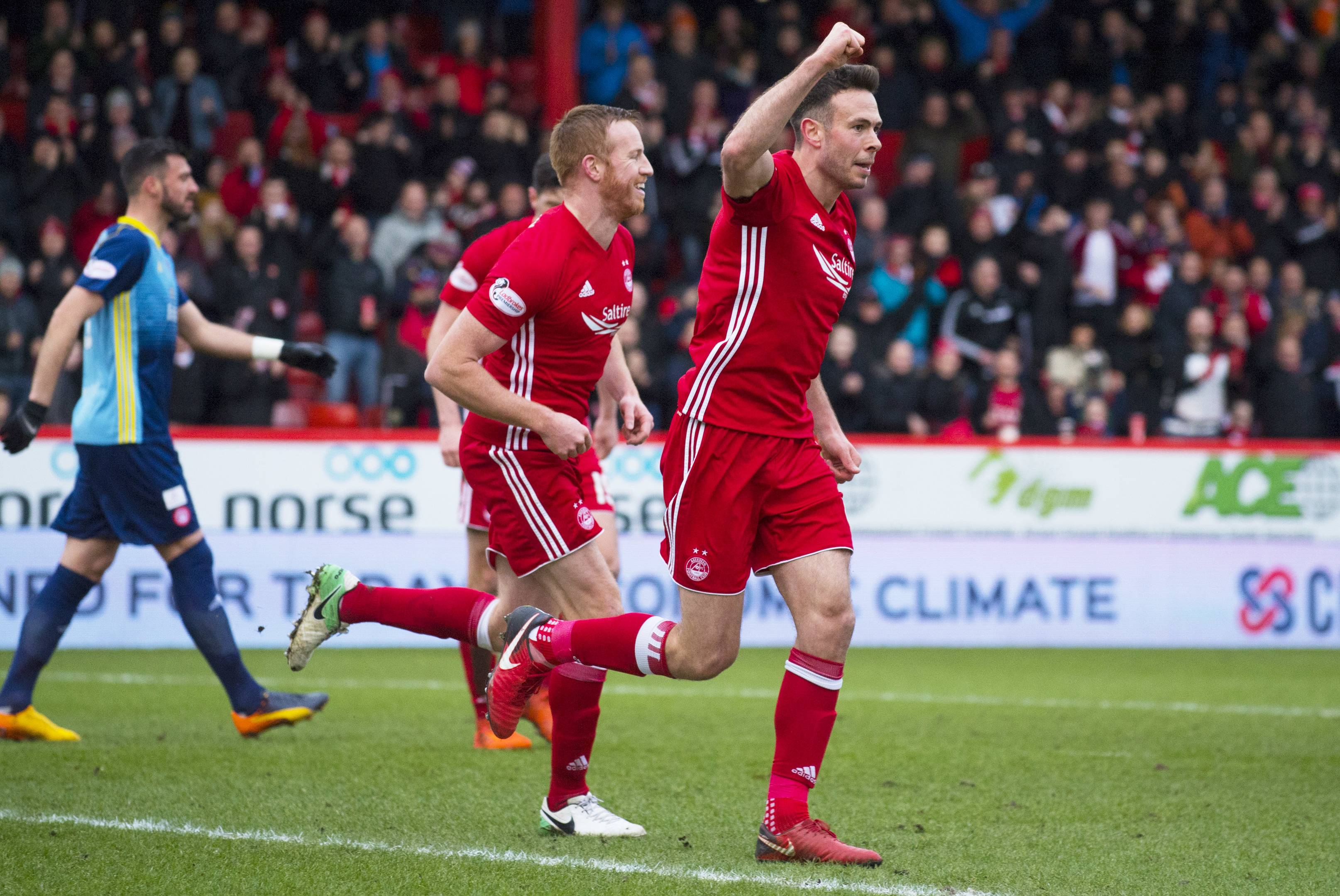 Aberdeen's Andrew Considine celebrates after making it 1-0.