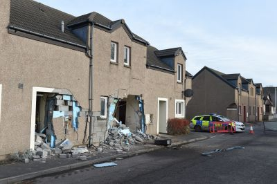 A construction tractor crashed into a sheltered housing complex, leaving a path of destruction behind.