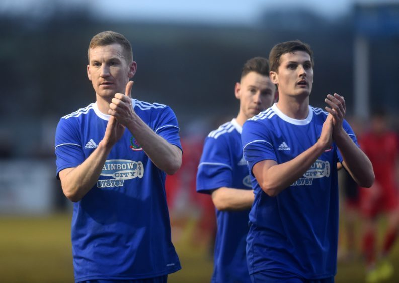 Cove players at full time. Captain Eric Watson and Daniel Park.