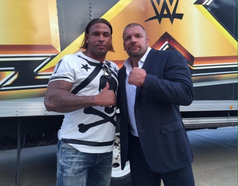 Tim Wiese with WWE legend Triple H.