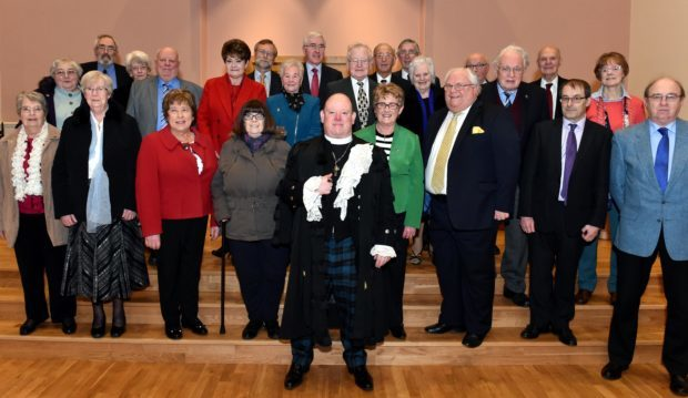 Right Rev Dr Derek presented long service certificates to 26 people including elders, sunday school teachers and choralists at a special ceremony at Mannofield Parish Church (Picture: Colin Rennie)