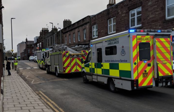 The emergency services at the scene.
