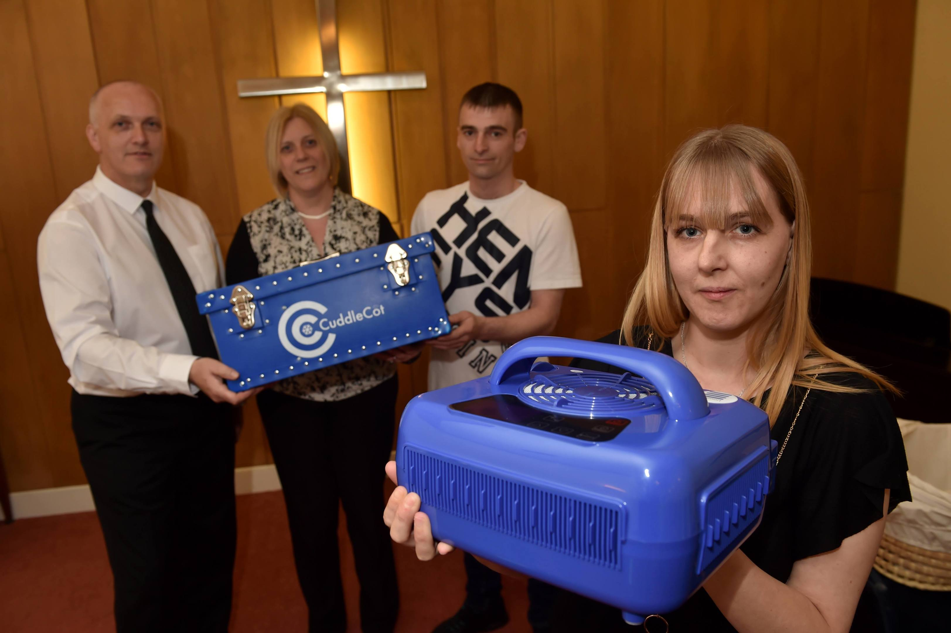 Michelle Annand presented a Cuddle Cot to Gordon & Watson Funeral Home, which she herself fundraised