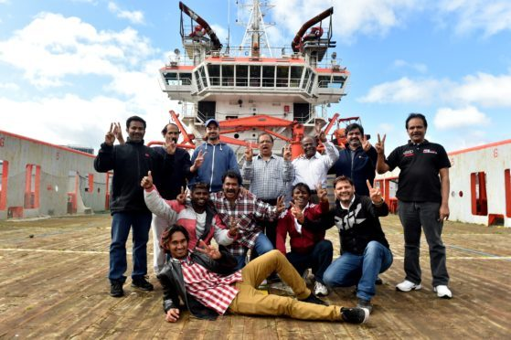 The crew of the Malaviya Seven in September last year after the news the ship could be sold