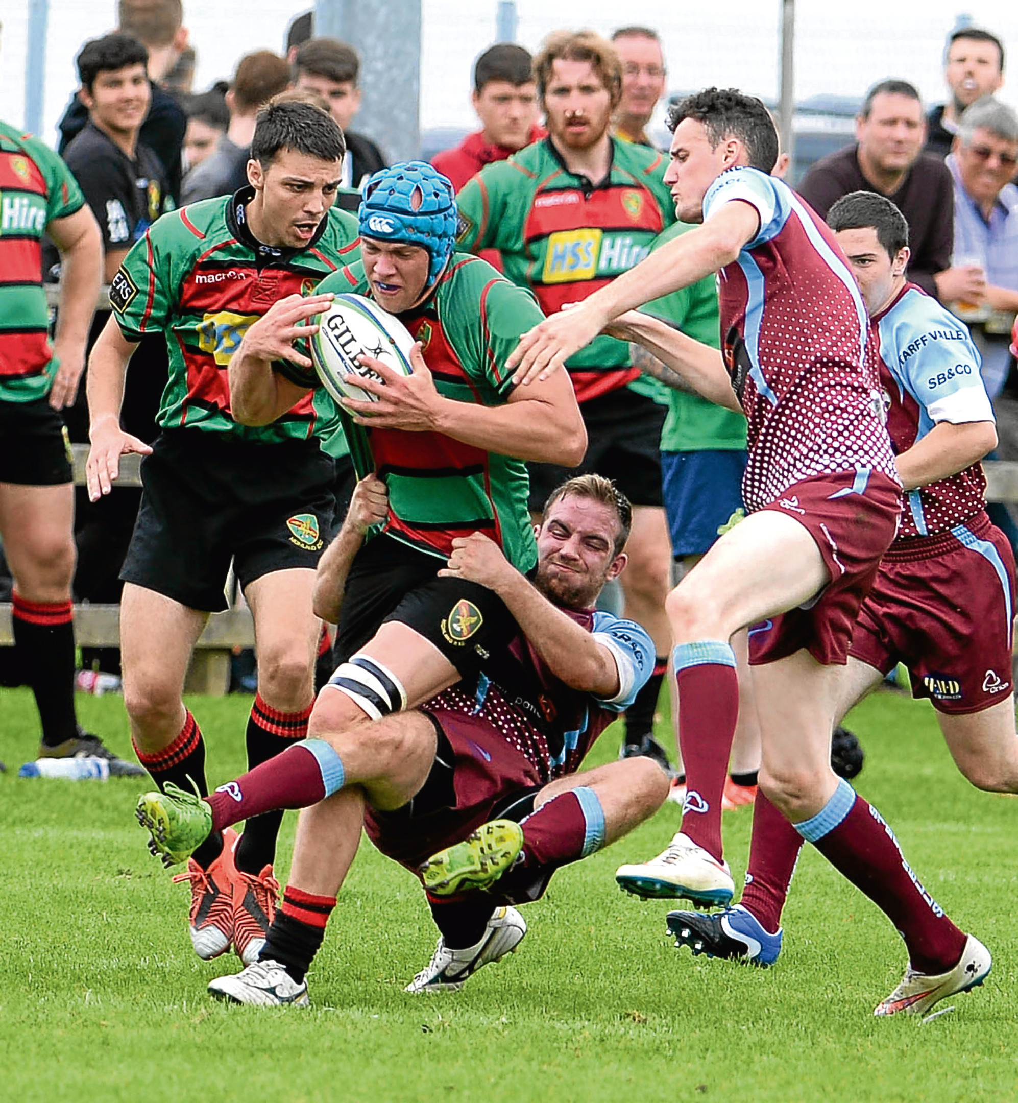 Highland RFC V St Boswells RFC BT Cup First Round It takes some desperate tackling to stop Highland's Stuart MacDonald. Pic - Phil Downie