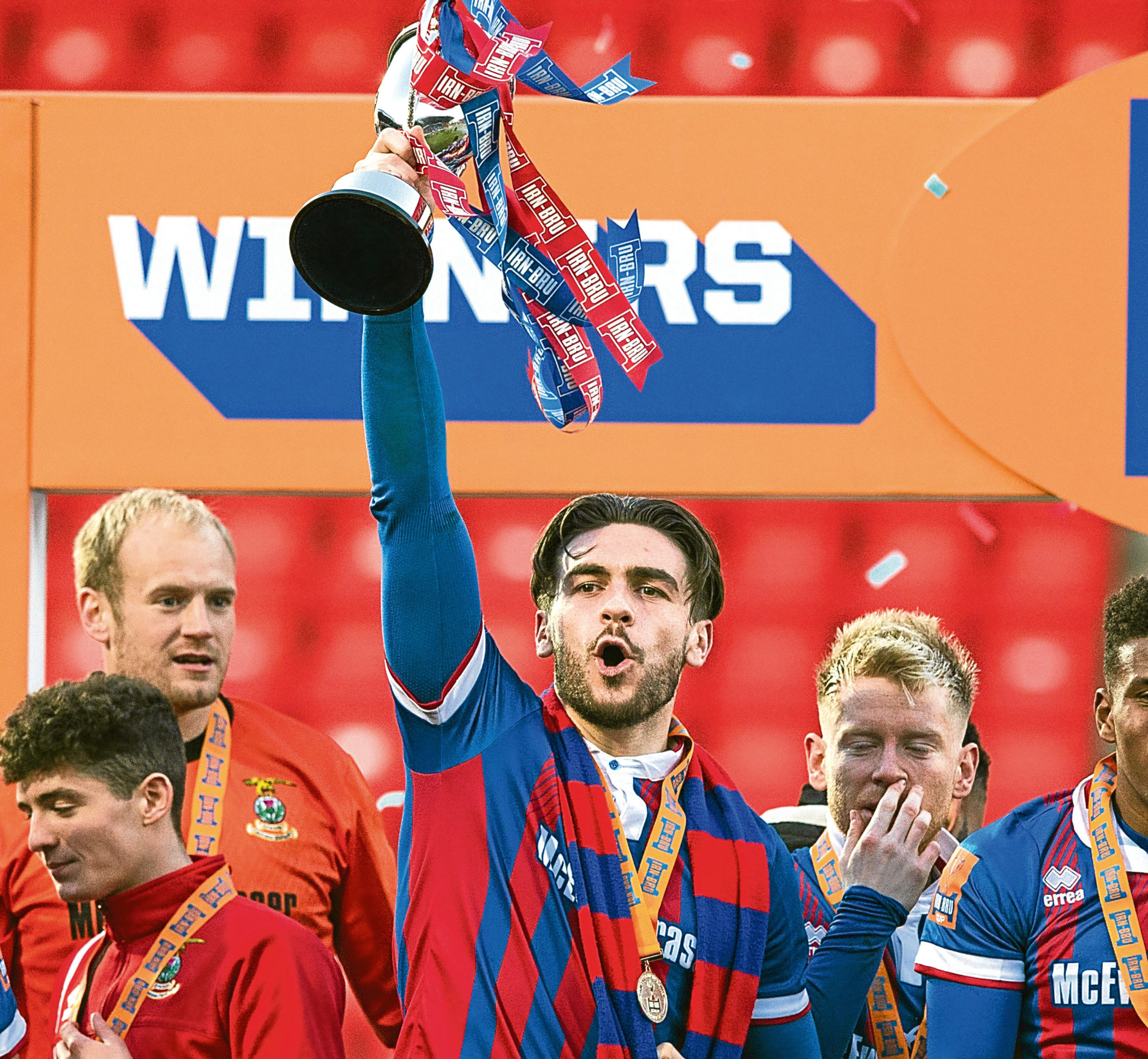 Inverness' George Oakley lifts the IRN-BRU Cup